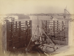 View of sea-gates from subsidiary dam looking westward [Victoria Dock construction, Bombay].